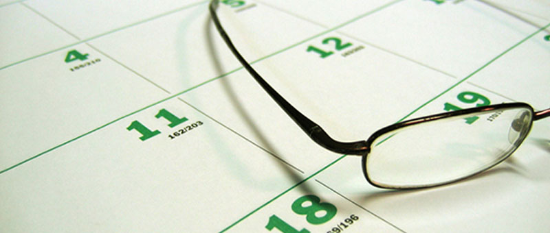 Glasses resting on a calendar.